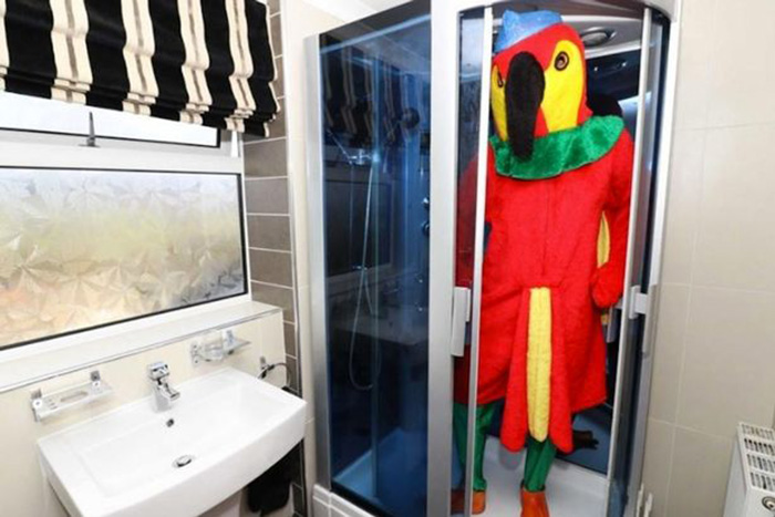 Man Dresses Up Like Parrot To Sell His House _ shower_ all created